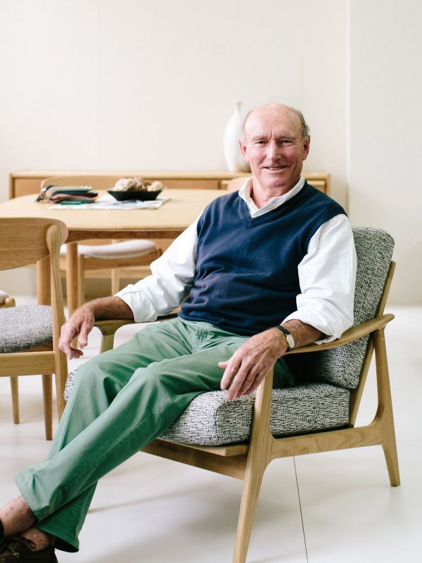 Tony Parker sits in his 'Showood Armchair' at Covemore Designs, who now produce his original designs under license, through Workshopped in Sydney. Photo – Rachel Kara for The Design Files.