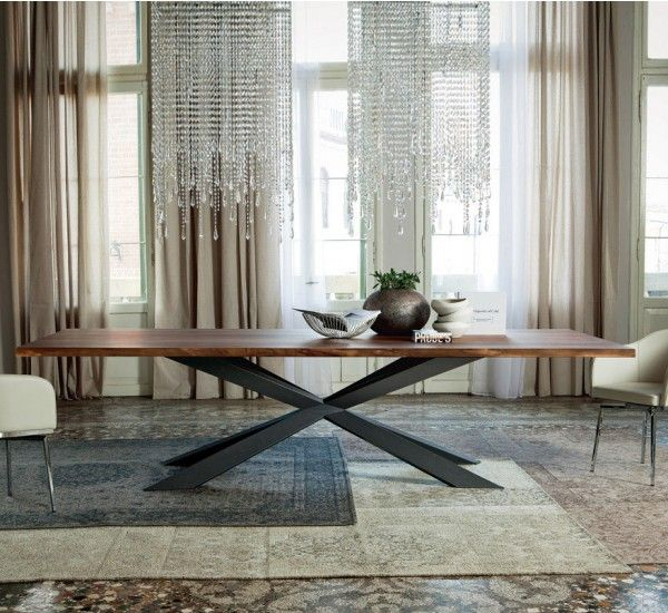 Spyder Wood is the table signed by Philip Jackson for Cattelan Italia.