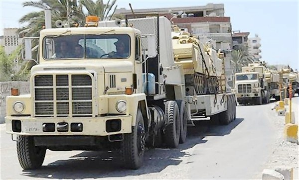 Egyptian army trucks carrying tanks and vehicles, expecting opposition against militants, arrive at Rafah city