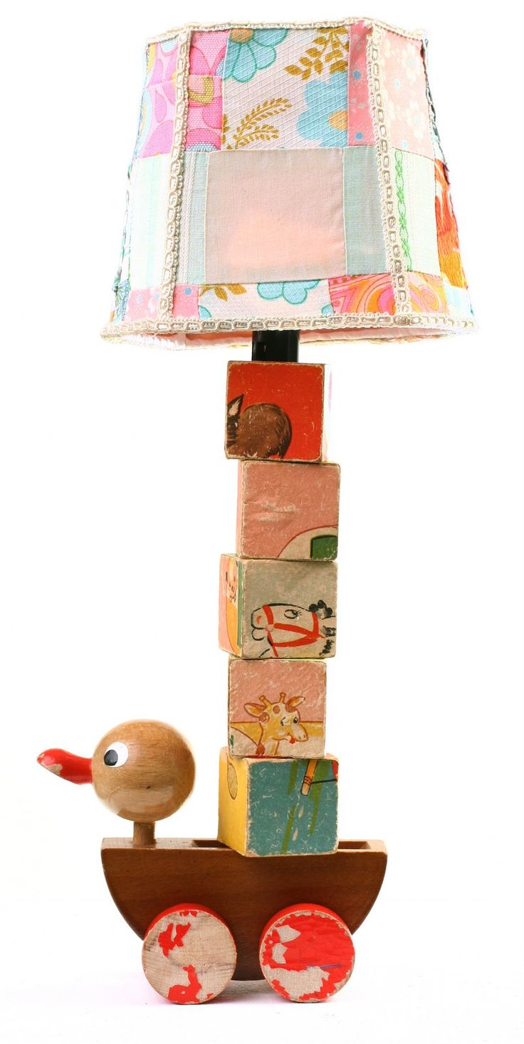 Lamp made with a vintage pull toy, old blocks and an upcycled lamp shade. ♥ cute cute & use the child's or persons name (last name) with the blocks - make it truly personalized