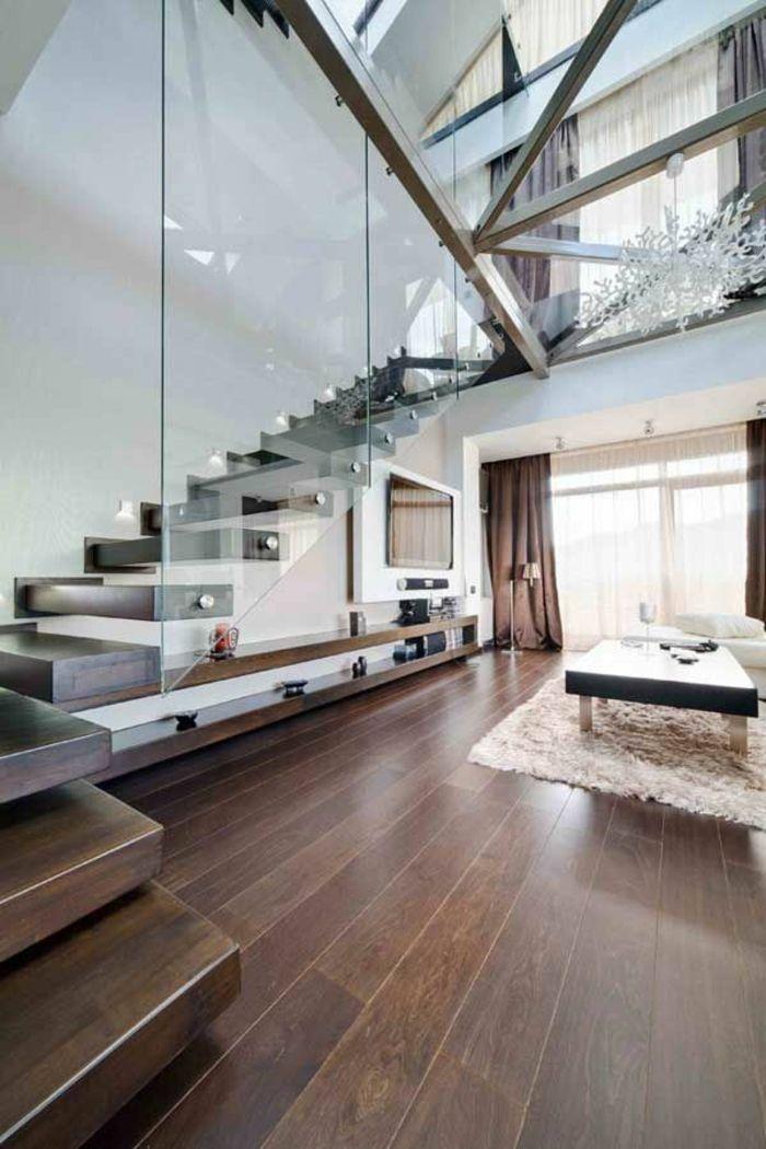 cloisons amovibles, parquette en bois foncé, tapis beige, table basse en bois