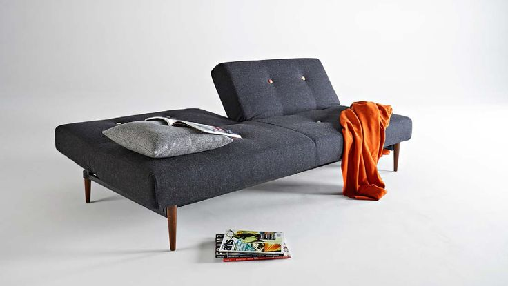 Fifty-nine sofa bed with multicoloured buttons. Classic mid century design from Innovation Living.
