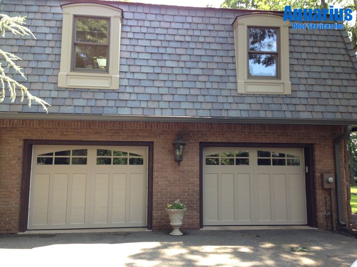 Clopay coachman collection steel carriage house style for Carriage style garage doors with windows
