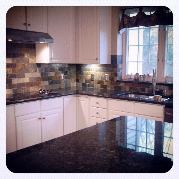 Enchanting Unique Granite Applied On White Cabinets: Exquisite Kitchen  Design Use White Kitchen Cabinets And Dark Marble Countertop With Granite  Backsplash ...