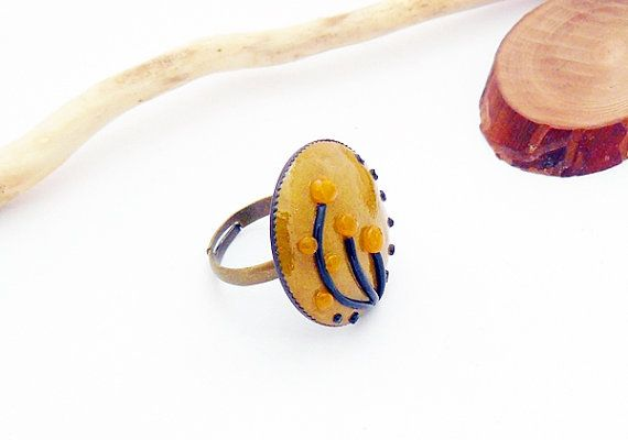 Gold yellow and black ring with flower  polymer clay by spikycake, $15.00
