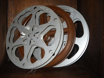 Film reels was used for the standard printing of film for the film industry. A typical reel was 1,000 feet long and would run for about 11 minutes of film that included sound. Projectionists would have to change the reels once they were done to switch over to the next scene. That is why is old movies you can see visible breaks for split seconds. Today digital cinema has become much more advanced and uses a system called Digital Cinema Package.