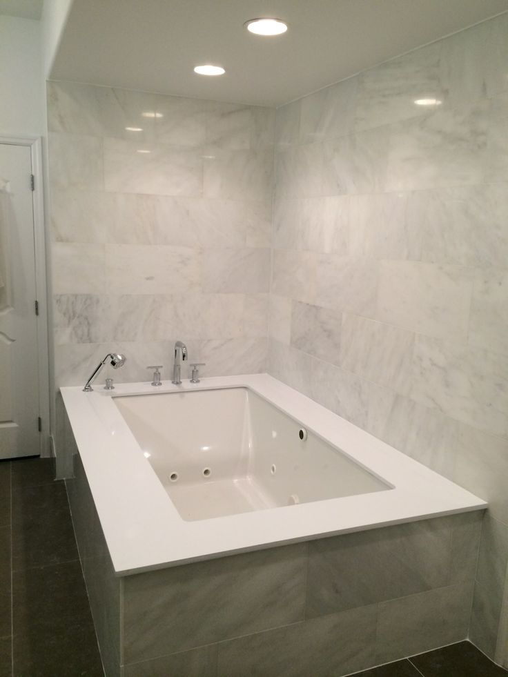 156 best our residential projects images on pinterest for Limestone tub