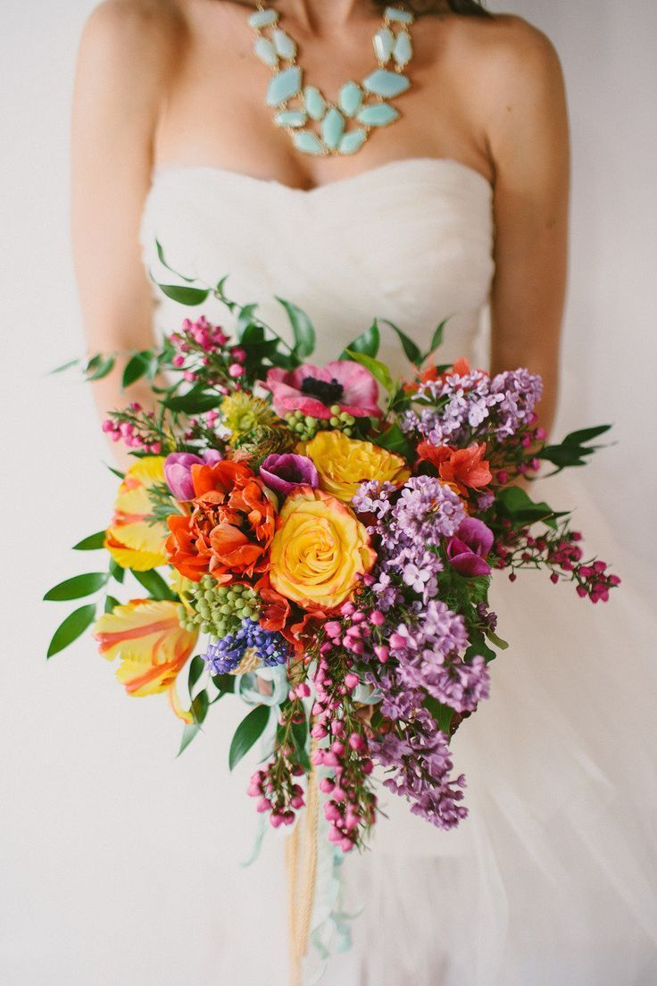 mix of colors purple and orange fall bridal bouquet