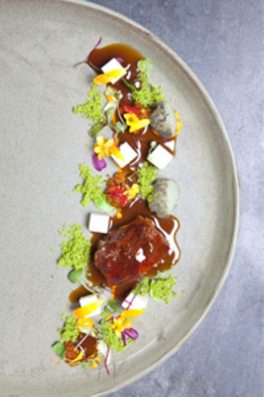 Braised lamb shoulder with coriander and pisco jus, black quinoa and white grape recipe by professional chef Robert Ortiz