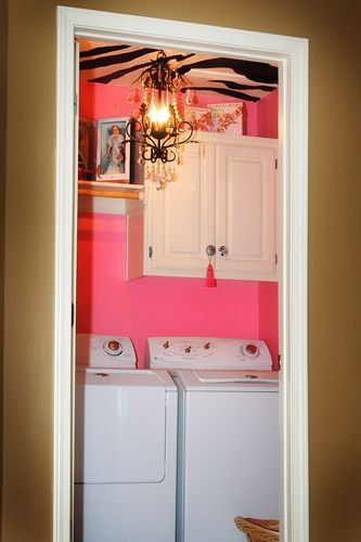 If you're using a small closet as a laundry room have some fun with it and have a little crazy decor! Love the surprise behind the door :)