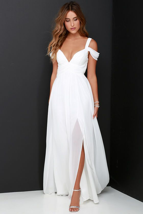From posh prom or lavish cocktail party, and from sea to shining sea, the Bariano Ocean of Elegance Ivory Maxi Dress will have you in the lap of luxury wherever you may go! Crisp ivory Georgette starts this exquisite ensemble off with tank straps (joined by sheer off-the-shoulder straps) that support a fitted bodice with a plunging sweetheart neckline, and elegant ruching details. Additional ruching delicately encircles an empire waistline, while a showstopping floor-length maxi with a…