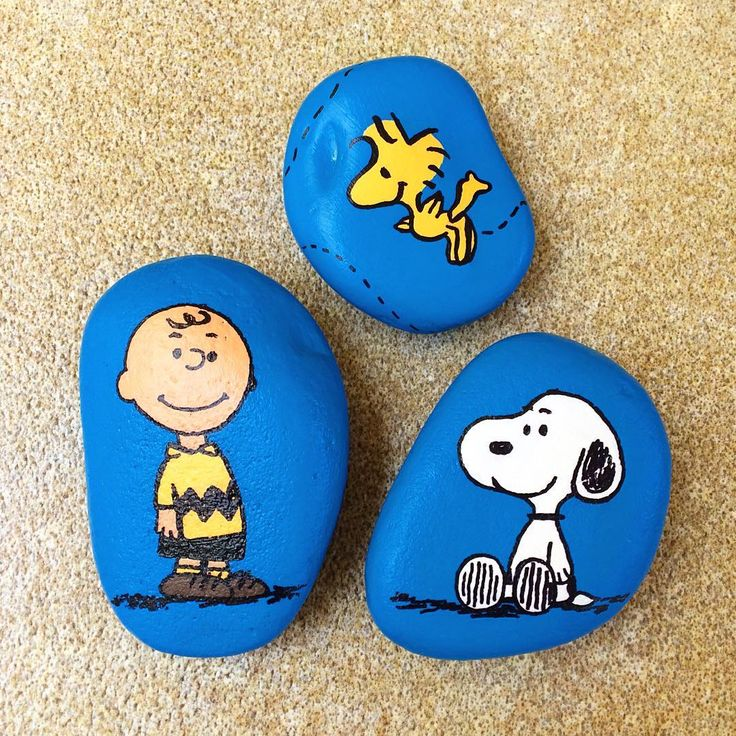 Peanut characters painted on stones