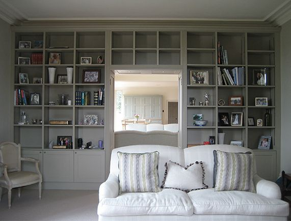Bespoke built-in painted bookcase, but also look at their website for a fab utility room finish for coats and gear.