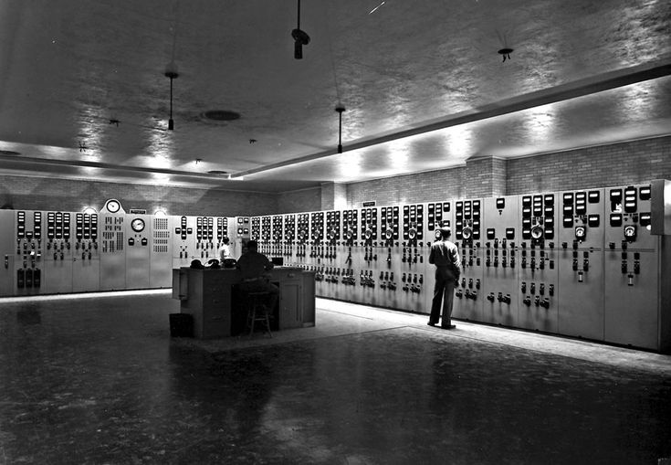 The main control room at the K-25 uranium enrichment plant in Oak Ridge, Tennessee. (Ed Westcott-the only authorized photographer on the facility/DOE); The U.S. government built the facility there for the Manhattan Project -- the secret World War II program that developed the atomic bomb