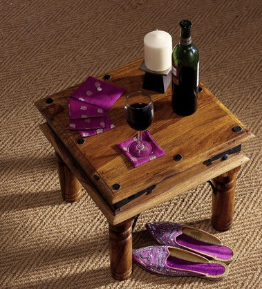 I like this coffee table because it has character.  What do you think?  And because it is fairly traded you feel good about using it.