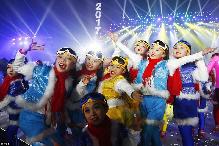 Performers gather and pose for photograph as they attend the count down event to celebrate the arrival 2017 new year during New Year's Eve celebration at Beijing Olympic Park in China
