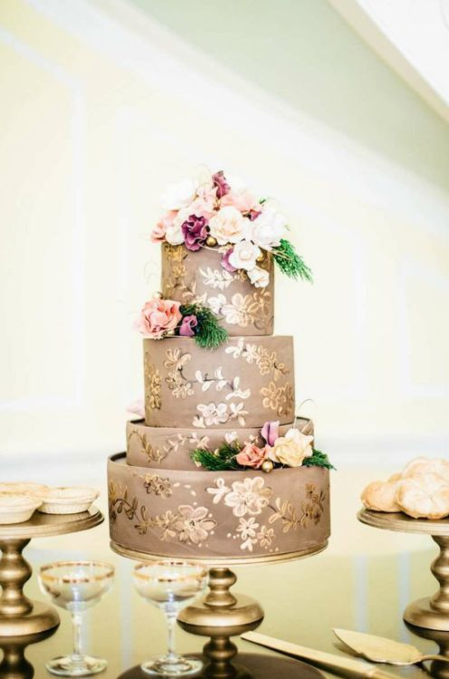 Gold And Floral Four Tiered Wedding Cake