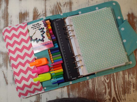 Adds a bit of style to your Filofax . Filofax wallet for A5 size Filofax. Features multiple pockets for pens, business cards washi tape. Fastens