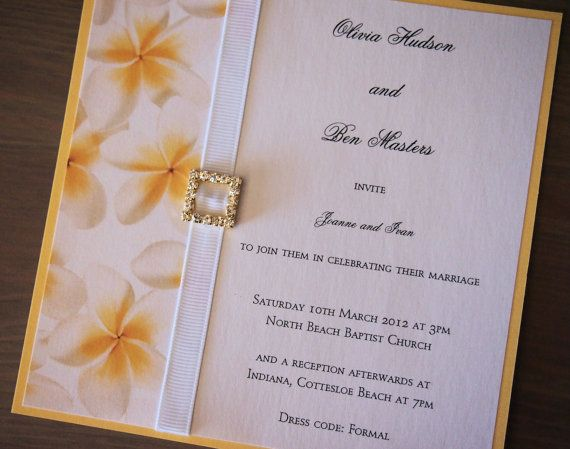 This wedding invitation called Tropical Sunshine has been made using pearlescent yellow card (250gsm), pearlescent frangipani deco paper, white grosgrain ribbon and a gold and crystal buckle. The invitation comes with a matching pearlescent white envelope. (https://www.etsy.com/listing/123950423/tropical-sunshine-wedding-invitation)