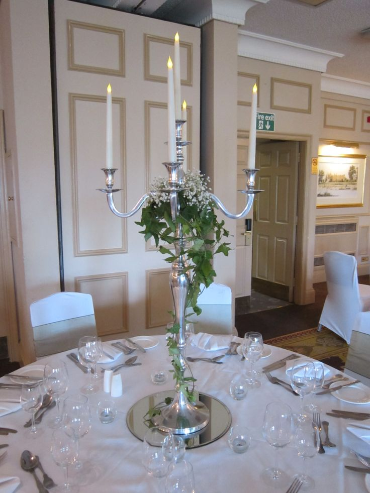 Candelabra with ivy and gyp  Wedding Ideas in 2019  Candelabra wedding centerpieces Wedding