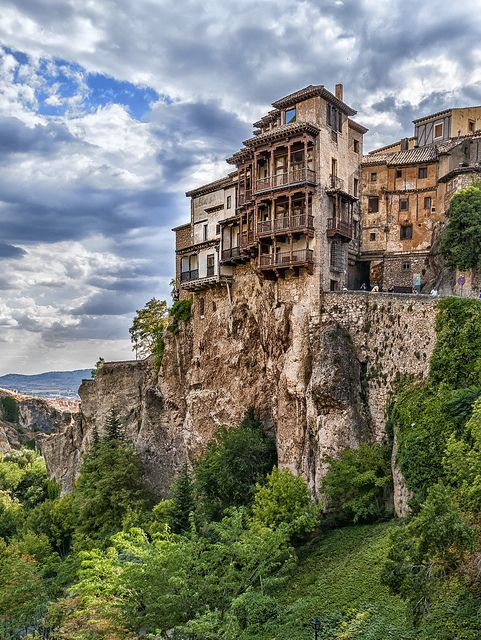 "Cuenca's unique hanging houses were constructed on the edge of a canyon's cliff back in 14th Century medieval times. The city of Cuenca is located to the east of Madrid, Spain. A two hour buss ride from Madrid the city offers modern and medieval urban realities. The old city is located up on the edge of the cliff of a deep canyon. Very interesting for its geology as well as medieval old ""hanging"" houses."