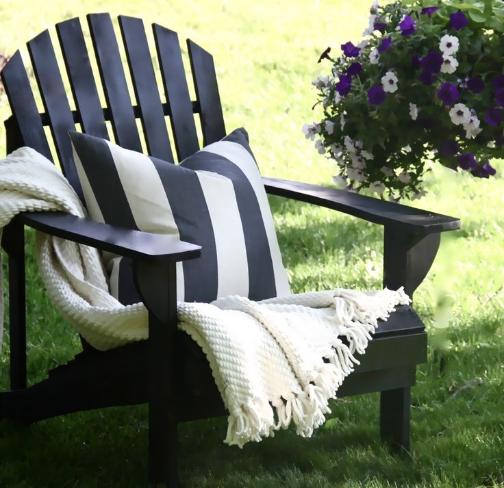 Unfinished Adirondacks for $38 from Home Depot - Painted and put together by The Yellow Cape Cod