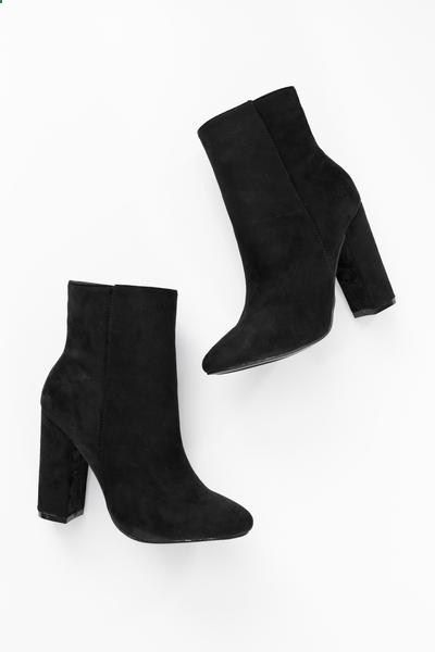 Black faux suede high ankle booties with side zipper and 4 heel. Lightly padded insole. Slightly pointed toe. This style runs small, be sure to order a half size up. - All man made material - Importe