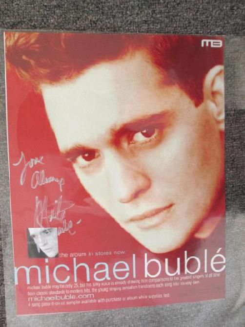 Original AUTOGRAPHED promo poster/vinyl window static cling for Michale Buble's self titled from 2003. HAND-SIGNED BY MICHALE BUBLE. 11 x 14 inches.