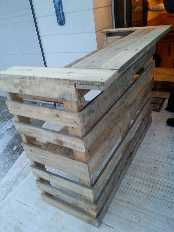 Handmade bar made from reclaimed pallet wood. The perfect accent to your outdoor or indoor bar area.