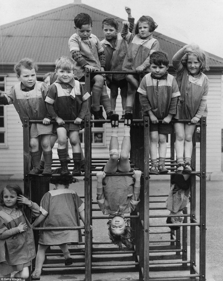 "Children in Swansea, Wales make the most of this climbing frame in April 1939.  We called it a ""jungle jim"""