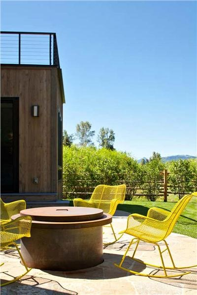 Love the yellow chairs in this brilliant outdoor space by Jennifer Visosky