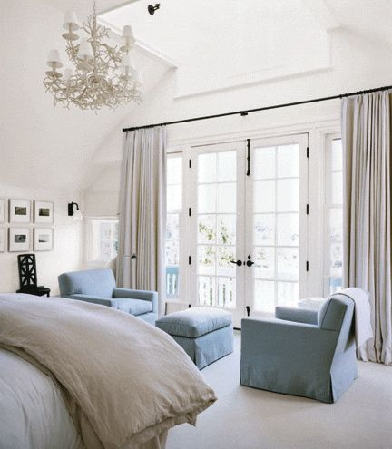 A soothing and soft bedroom full of light. Designer tip: Hang curtains extra wide to let in as much light as possible.