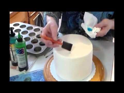 How to paint on a fondant cake using liquid food colorings. This is part 1 of 2 videos.