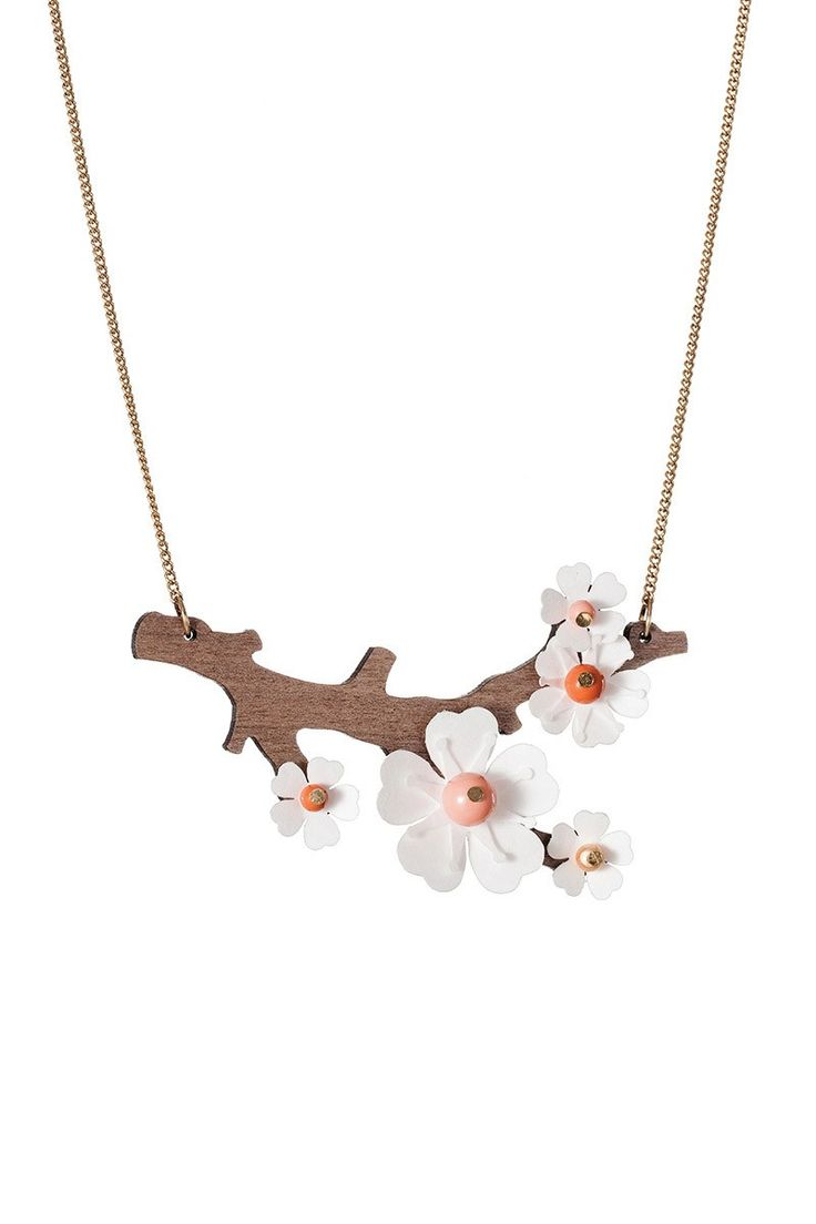 Cherry Blossom Necklace by Tatty Devine. Wood looks laser cut.  Not sure how she did the beads, but it's gorgeous!  50 pounds