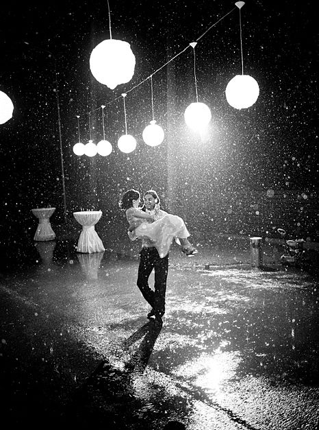 Carried over puddles. Rain wedding photography. Image: Andres Zavadskis #rain #wedding
