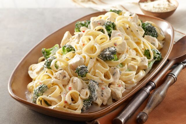 Rich Chicken Alfredo recipes may seem complicated to make, but it's a snap when you know this shortcut. A creamy cheese sauce tops chicken, fettuccine and fresh broccoli. Plus you can make this Chicken Broccoli Alfredo in 20 minutes flat.