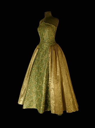 1996 - Queen Silvia of Sweden - Nobel Banquet -  This gown is made of green silk with a gold lace finish. The gold overskirt is made from very light ottoman. Designed by Jacques Zehnder,  Paris.