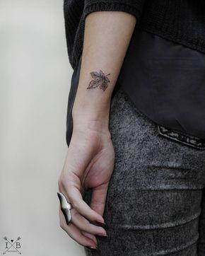 Fall maple leaf tattoo by Irene Bogachuk