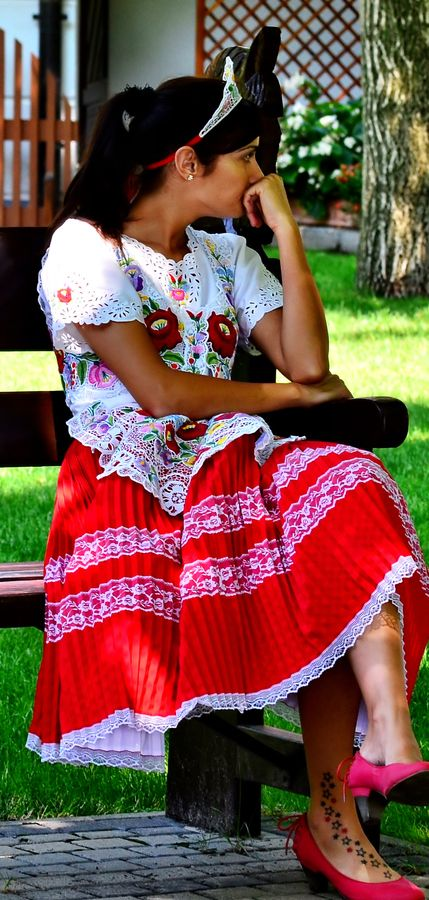 Hungarian folk costume, love how she is celebrating her heritage, but you can see she likes modern culture too (see tattoo)