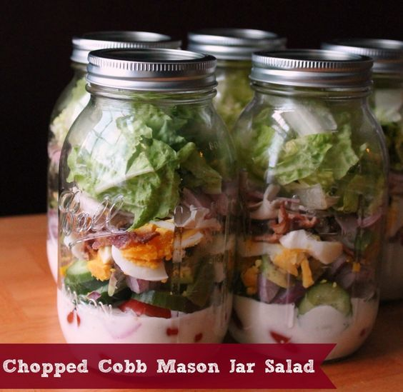 Great way to use leftover ham and hard boiled eggs with tomatoes, cucumbers, red onion, avocados, bacon, turkey and lettuce. Delicious Chopped Cobb Mason Jar Salad make ahead lunch recipe idea from OrganizeYourselfSkinny.com