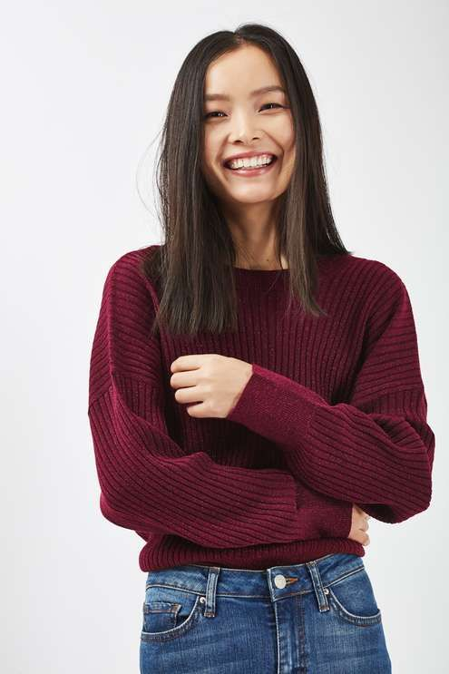 A simple way to add subtle glamour to your casual wear, this ribbed batwing-sleeve jumper comes in a red metallic finish with cool v-back detail. Wear tucked into jeans for effortless feel. #Topshop
