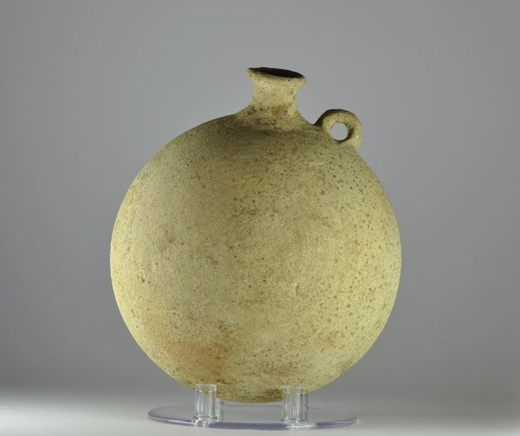 Roman pilgrim flask, 1st century A.D. Roman pilgrim flask, Eastern Mediterranean Holy land pottery pilgrim flask with one little handle used to carry Holy water from pilgrims, 18.2 cm high. Private collection