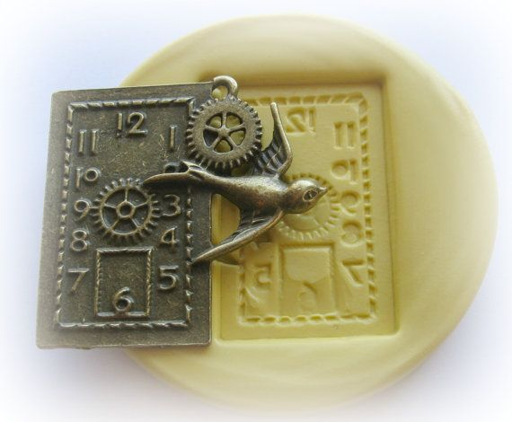 Silicone mold for resin.  steampunk swallow and gears.
