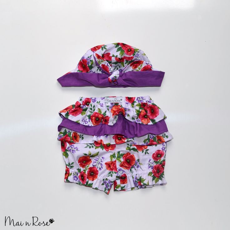 "Our ""Poppies"" hat and bloomer set is a must have for this summer! Made from 100% cotton, the hat keeps your little one protected from the sun while the bloomers cover up that nappy with adorable ruffles, so your bub can get around in style.Reversible hat - can be worn either Poppies or Purple**Purple ruffles only on Size 6-9 months***[Shipping includes tracking]"