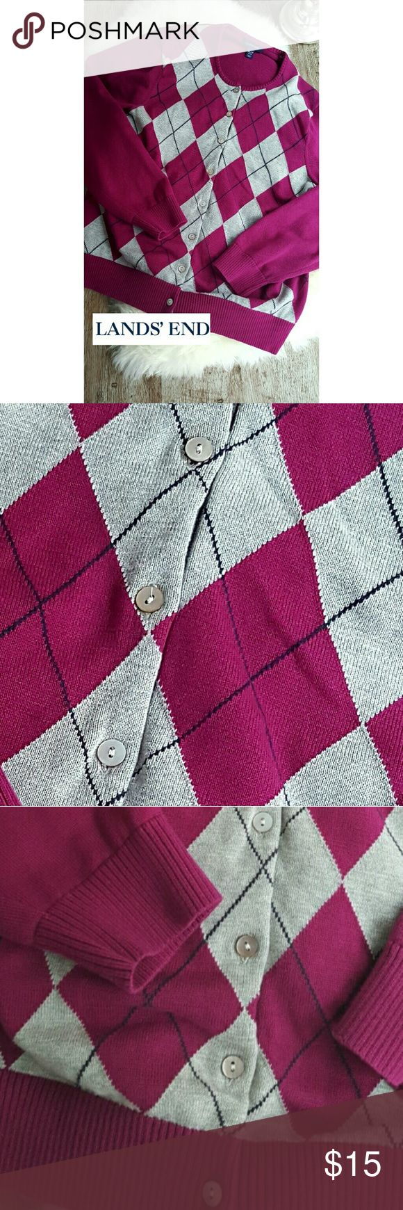 """LANDS'END LIGHT ARGYLE CARDIGAN Pretty yet practical, this light weight cardigan from quality clothing company LANDS' END is perfect for chillier spring days and summer nights with a breeze. This sweater features fuschia, gray, and black argyle patterns on the front with a solid fuschia back. Button down front. 100% cotton.   SIZE XL/ P  (18-20) ARMPIT TO ARMPIT: 21"""" SHOULDER TO HEM: 23"""" Measurements are taken laying flat and are APPROXIMATE!   ALL ITEMS FROM A NON-SMOKING home.  BUNDLE AND…"""