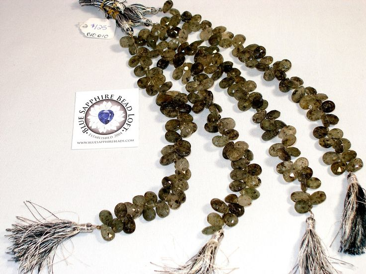 Moss Quartz  SKU B10010  List Price $125.00  Weight 31.00 G  Length: 210.00 MM  Width: 8.50 MM  Height: 10.50 MM  Gorgeous Earthy tones.  Faceted Teardrops.