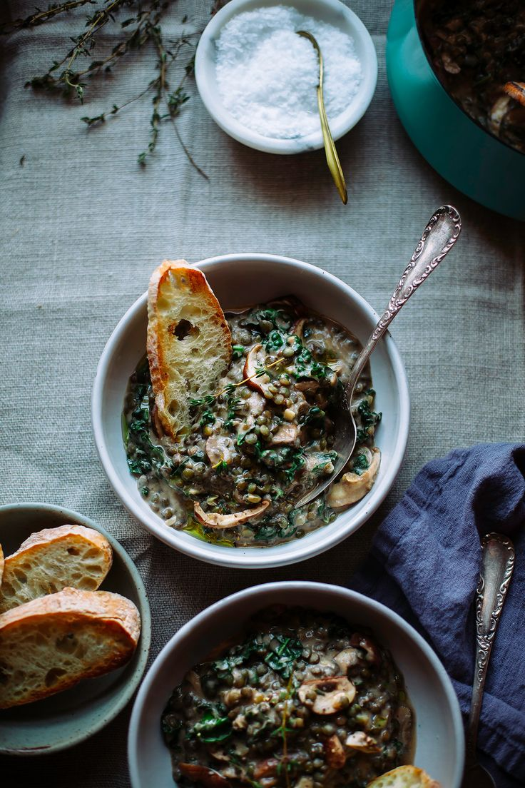 Creamy French lentils are cooked with sliced mushrooms and kale for a healthy, vegan entree.