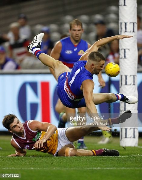 Matthew Suckling of the Bulldogs and Ben Keays of the Lions compete for the ball during the AFL 2017 JLT Community Series match between the Western...