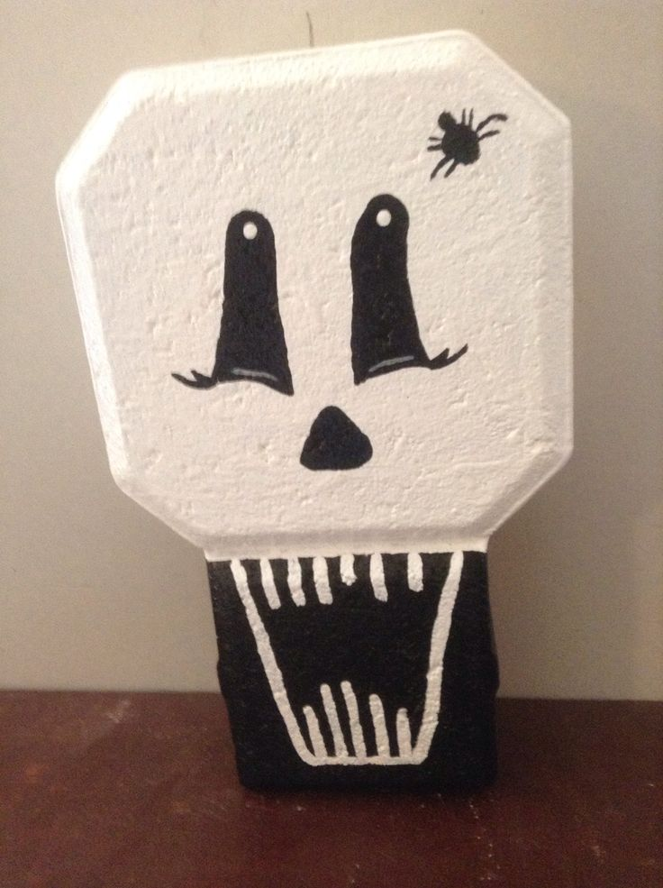 On a keyhole paver I painted this ghost for Halloween