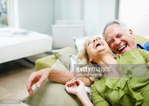 Stock Photo : Couple laying on sofa together